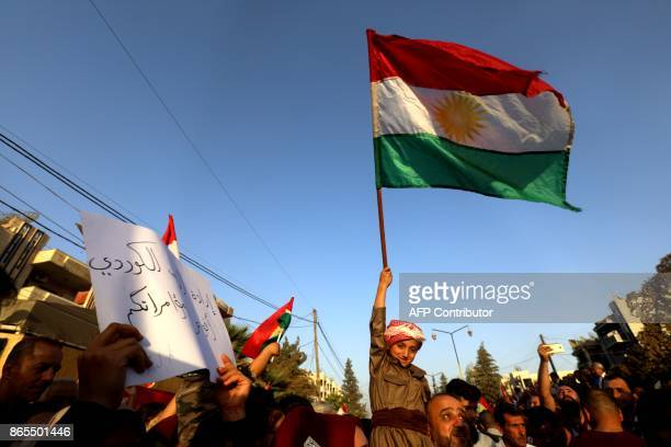 Syrian Kurds demonstrate in the northeastern Syrian city of Qamishli on October 23 2017 against Iraqi forces operation in the multiethnic city of...