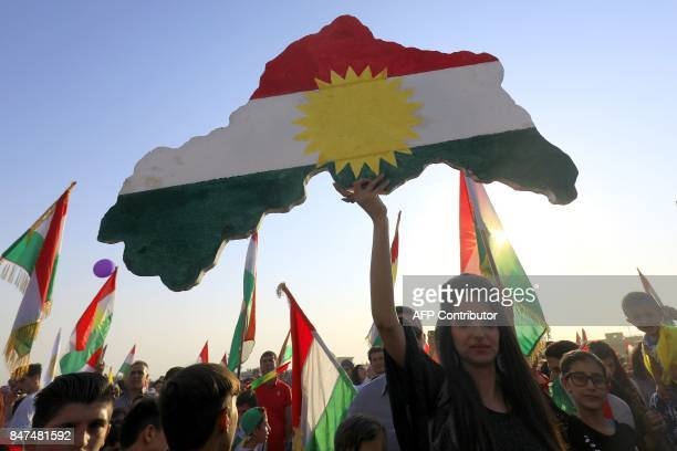 TOPSHOT Syrian Kurds take part in a rally in the northeastern Syrian city of Qamishli on September 15 in support of an independence referendum in...