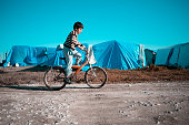 syrian child, bike, camping, Syria