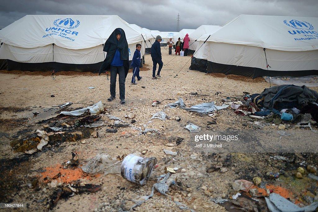 ZA'ATARI JORDAN JANUARY 31 Syrian look at a tent burned down in the Za'atari refugee camp on January 31 2013 in Za'atari Jordan Record numbers of...