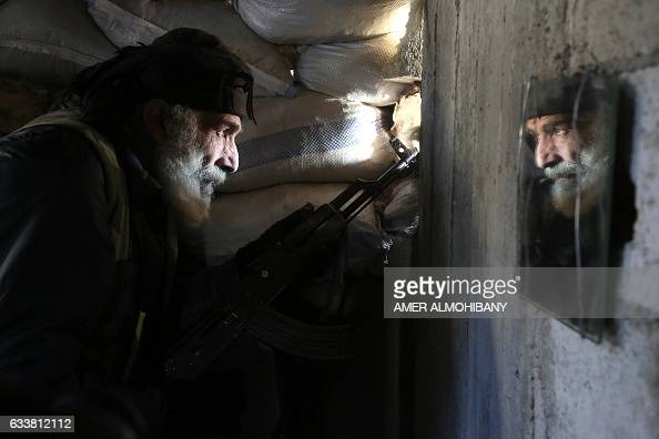 TOPSHOT Syrian Mahmoud AlKhatib a fighter from the Jaish alIslam the foremost rebel group in Damascus province who fiercely oppose both the Syrian...