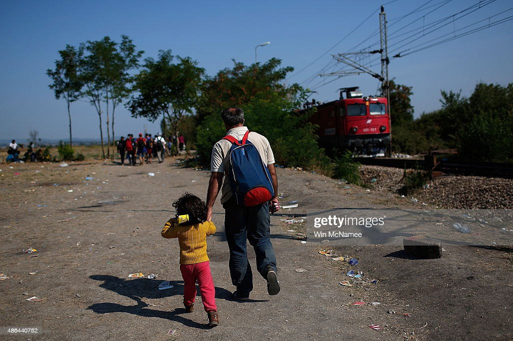 A Syrian man and his young daughter begin a walk that will take them into Serbia after a train that brought them from the Macedonian border with Greece arrived at a camp near a border crossing between Macedonia and Serbia September 4, 2015 in Tabanovtse, Macedonia. After stopping at a Serbian processing facility for migrants only, most migrants will continue on foot for the next 6 miles into the Serbian town of Preshevo. Since the beginning of 2015 the number of migrants using the so-called 'Balkans route' has exploded with migrants arriving in Greece from Turkey and then travelling on through Macedonia and Serbia before entering the EU via Hungary. The number of people leaving their homes in war torn countries such as Syria, marks the largest migration of people since World War II.