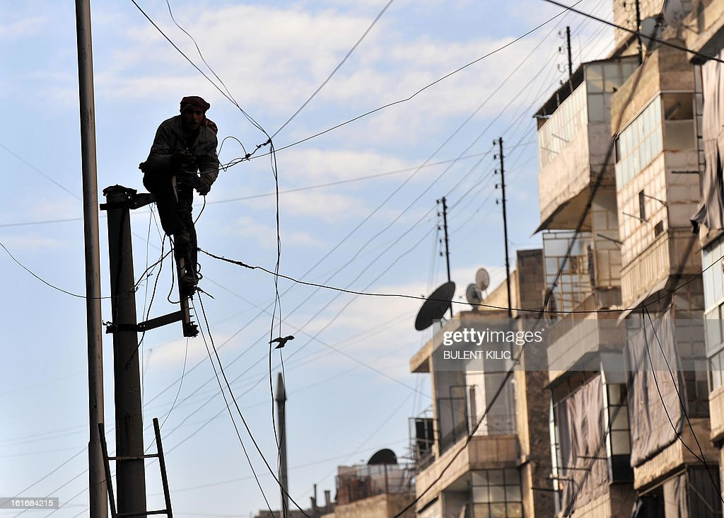 A Syrian man attempts to fix the electricity cables in the northern city of Aleppo on February 14, 2013. Syrian Foreign Minister Walid al-Muallem and opposition National Coalition chief Ahmed Moaz al-Khatib will make separate visits to Moscow for talks in the coming weeks, a top Russian diplomat said.