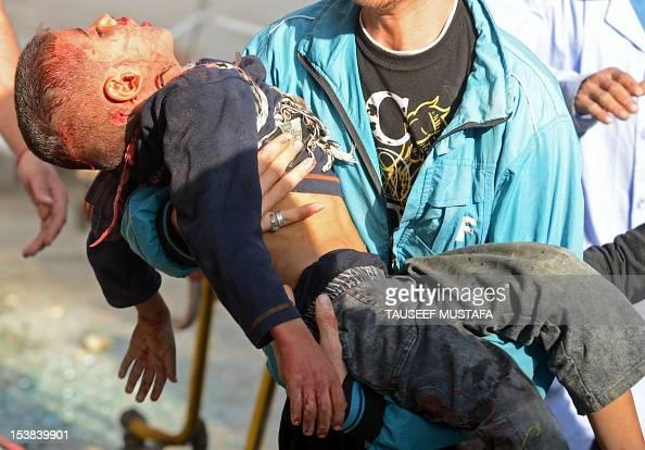 Syrian man carries the body of fiveyearold Mohammed Mustafa outside a hospital following shelling by Syrian government forces during battle with...