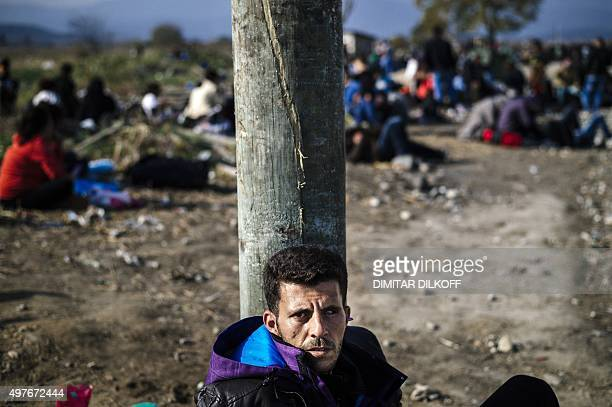 A Syrian man from Daraa waits to enter a registration camp along with other migrants and refugees after crossing the GreekMacedonian border near...