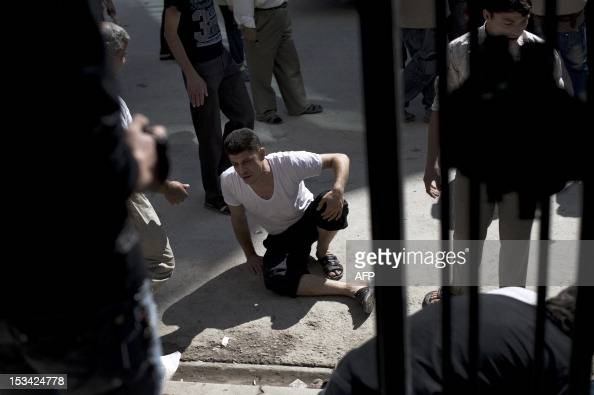 A Syrian man grieves the loss of his relatives killed in the shelling on a refugee center by government forces at the Dar alShifa hospital in the...