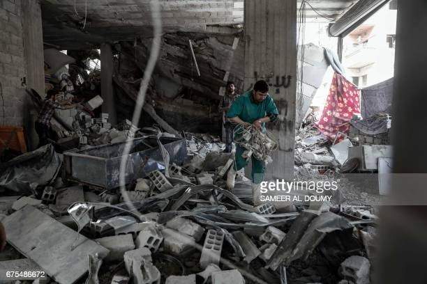 A Syrian man inspect a hospital damaged following an air strike a rebelcontrolled town in the eastern Ghouta region on the outskirts of the capital...