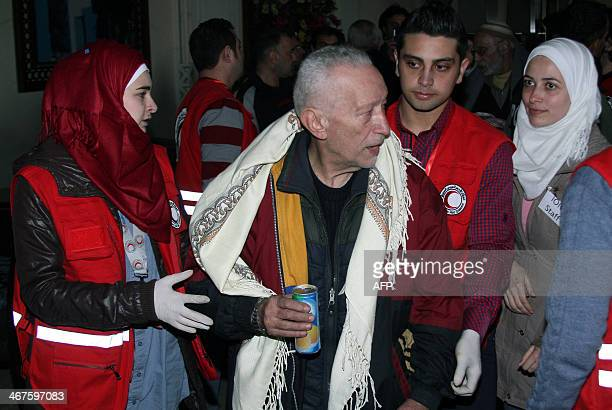 A Syrian man is helped by a Syrian Red Crescent worker upon his arrival in regimeheld areas of the Syrian city of Homs on February 7 after more than...