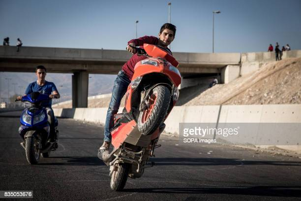 Syrian man is pictured on his motorcycle during the weekends where the unfinished highway from Beirut to Damascus becomes a safe haven for local...