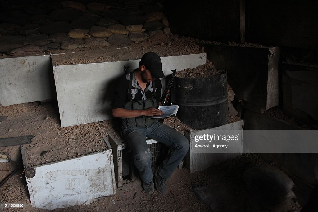 Syrian man reads Quran during the Islamic holy month of Ramadan at Cobar district of eastern Goutha despite the airstrikes of Syrian regime forces in...