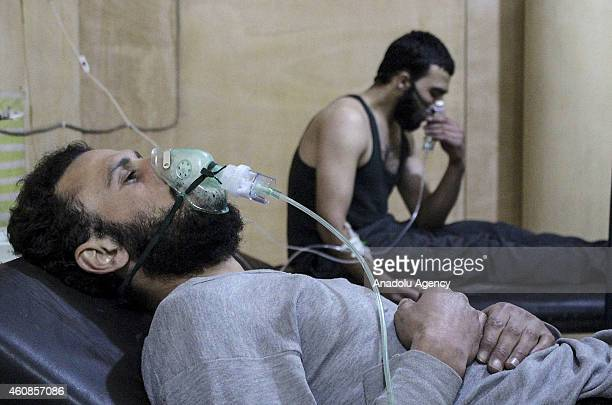 Syrian man receives medical treatment after Assad forces allegedly use poison gas in Jobar district of Damascus Syria on December 27 2014
