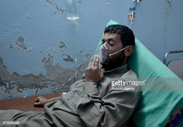 Syrian man receives treatment at a field hospital following a suspected chlorine gas attack by Assad regime forces in Idlib Syria on May 03 2015