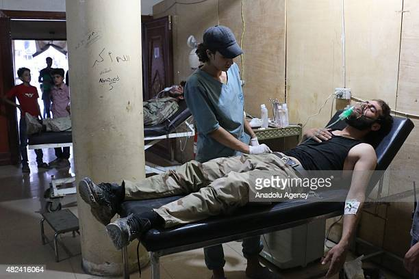 Syrian man receives treatment at a field hospital following a chlorine gas attack by Assad regime forces in Jobar town of Damascus Syria on July 30...