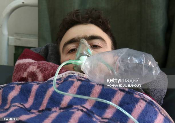 A Syrian man receives treatment at a small hospital in the town of Maaret alNoman following a suspected toxic gas attack in Khan Sheikhun a nearby...