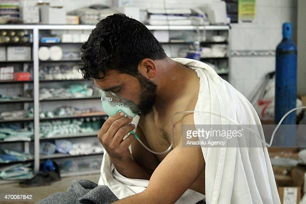 Syrian man receives treatment at the Sarmin field hospital following a suspected chlorine gas attack by Asad regime forces in Idlib Syria on April 17...