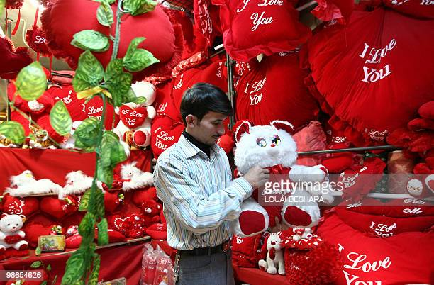 A Syrian man shops for Valentine's Day at a gift shop in Damascus on February 13 2010 Valentine's Day celebrated on February 14 is named after the...