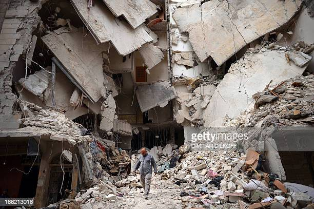 A Syrian man walks amid destruction in the northern Syrian city of Aleppo on April 10 2013 The United States is mulling ways to step up support for...