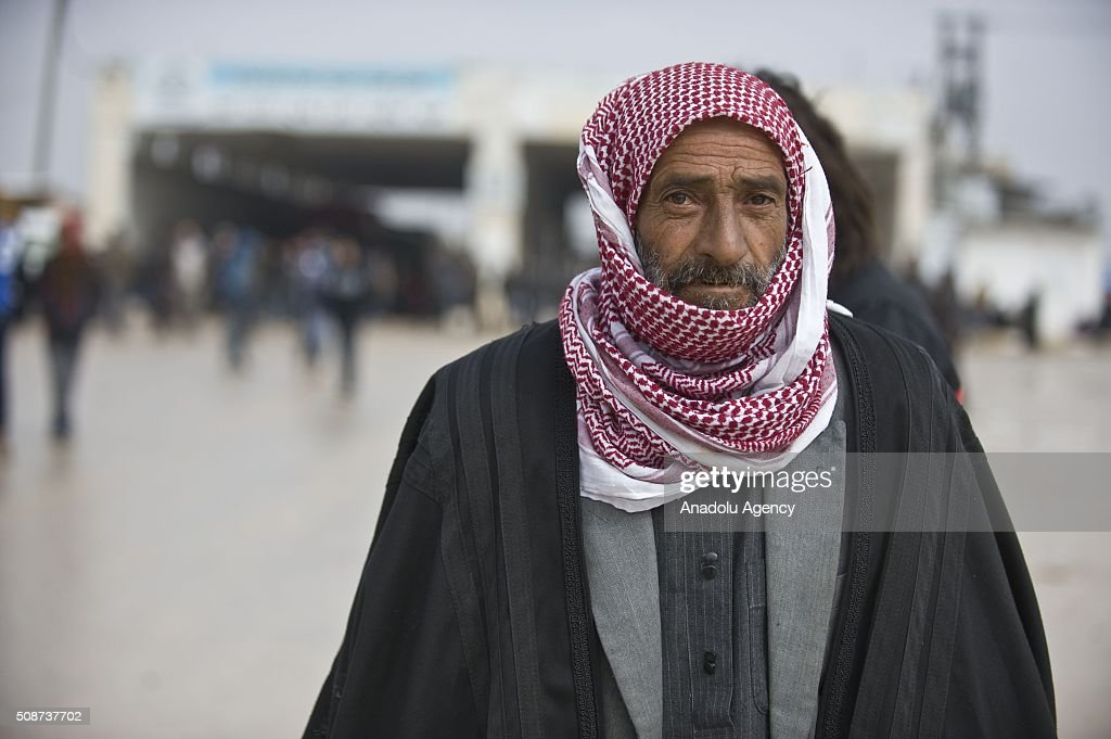 A Syrian man who fled bombing in Aleppo, is seen at the Oncupinar crossing, opposite the Turkish province of Kilis, near Azaz town of Aleppo, Syria on February 6, 2016. Thousands of Syrians have massed on the Syrian side of the border seeking refuge in Turkey.
