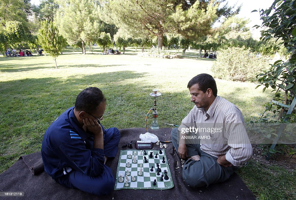Syrian men play a game of chess in a park in the capital Damascus on September 20, 2013. A senior Syrian official, said Damascus wanted a ceasefire in the 30-month war, which has reportedly killed more than 110,000 people and forced more than two million to flee.