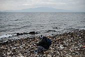 Syrian migrant looks towards the open sea from the Yesil liman district of Canakkale northwestern Turkey after being stopped by Turkish gendarme in...