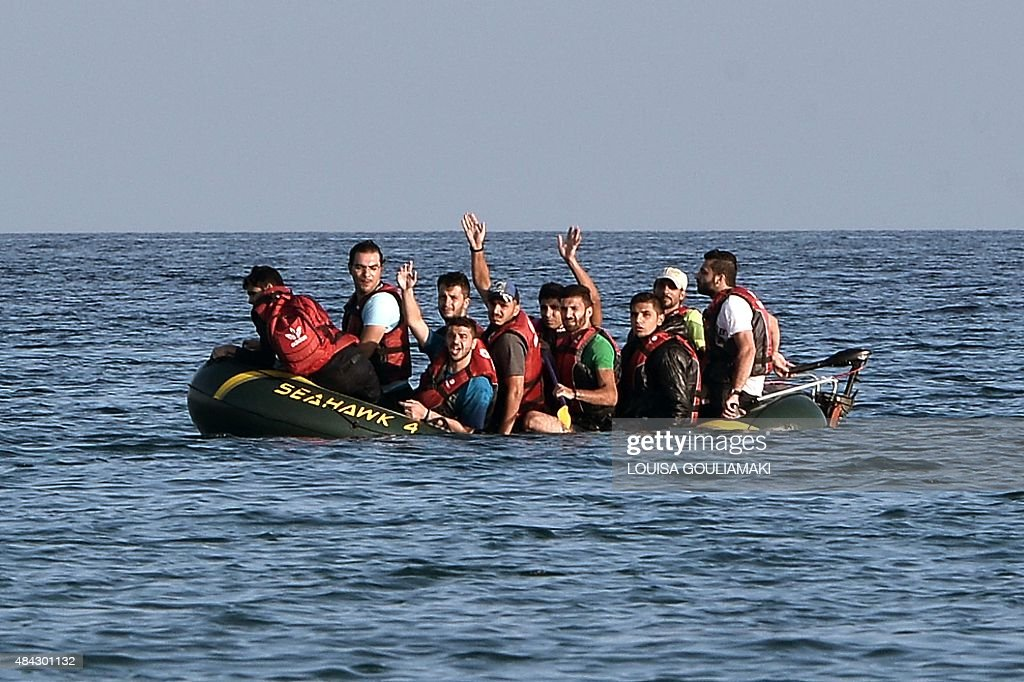 Syrian migrants call for help from their halfsunk small dinghy as they arrive to the shores of the Greek island of Kos on August 17 2015 Their small...