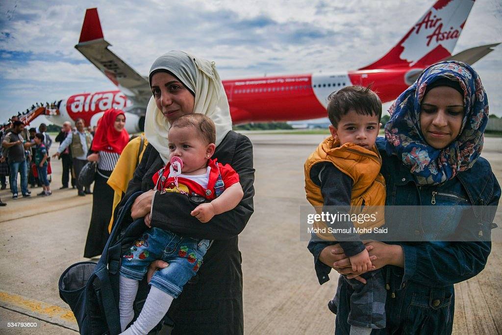 Syrian migrants, from the Bekka Valley refugee camp in Lebanon, arrive with their children at the Royal Malaysian Air Force (RMAF) Base on May 28, 2016 in Subang Jaya, Malaysia. Malaysia has received almost 68 Syrian immigrants that have been selected to join this migrant program. Prime Minister Najib Razak has announced at the 70th United Nations Assembly that Malaysia would open its doors to 3,000 Syrian refugees in three years to help in the refugee crisis.