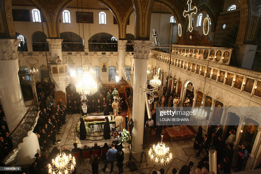 Syrian mourners attend the funeral of Greek Orthodox patriarch of Syria, Ignatius IV Hazim, at the Meriamiah Church in the Syrian capital Damascus on December 10, 2012. The patriarch died of a stroke in the Lebanese capital Beirut on December 5.