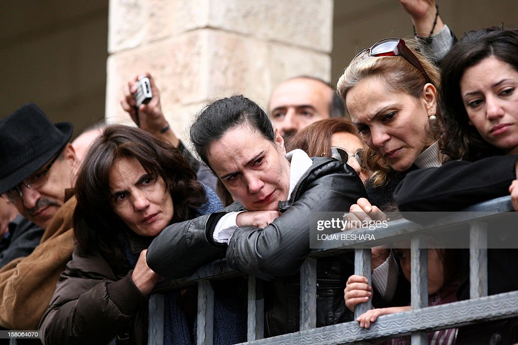 Syrian mourners attend the funeral of Greek Orthodox patriarch of Syria, Ignatius IV Hazim, at the Meriamiah Church in the Syrian capital Damascus on December 10, 2012. The patriarch died of a stroke in the Lebanese capital Beirut on December 5. AFP PHOTO/ LOUAI BESHARA