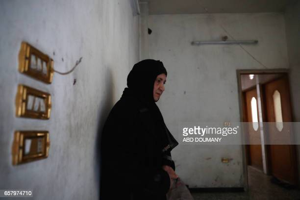 Syrian Naheel a sixtysixyear old widow who was displaced from the alMaliha area due to the ongoing fighting stands inside a room in her home in the...