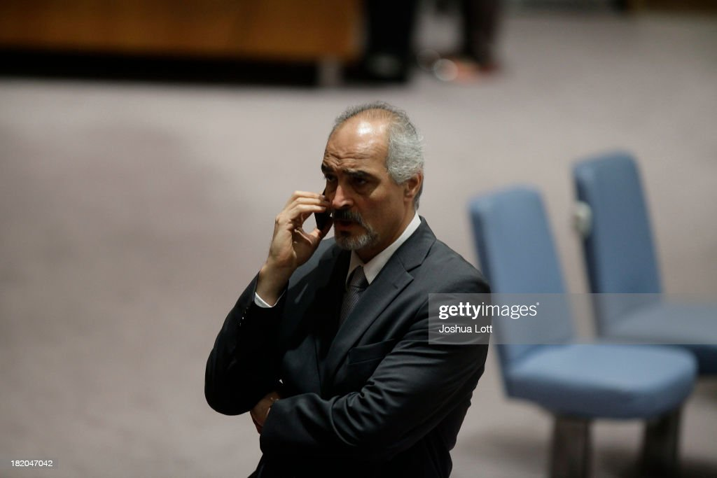 Syrian National Coalition Moaz al-Khatib speaks on the phone before a United Nations Security Council vote September 27, 2013 at U.N. headquarters in New York City. The Security Council today voted unanimously on a resolution that compels Syria to give up its chemical-weapon stockpile or face consequences. To that end, it requires unfettered access to international chemical-weapons experts, according to published reports. (Photo by Joshua Lott/Getty Images