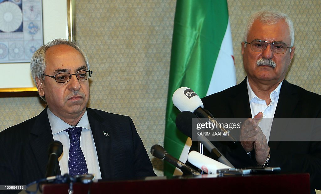 Syrian National Council (SNC) outgoing chief Abdel Basset Sayda (L) stands with the newly elected chief George Sabra (R) during a joint news conference on the sidelines of the SNC General Assembly in Doha, on November 10, 2012. George Sabra, a Christian activist and former member of the Syrian Communist Party, has become the third elected president of the main opposition bloc SNC. Elected late November 9, at the meeting in Doha, Sabra is a geography teacher by profession and a prominent Syrian dissident. He served jail terms under the rule of both the late president Hafez al-Assad and his son Bashar.