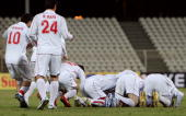 Syrian national football players kneel in prayer to celebrate their victory during their group D 2011 Asian Cup qualifying football match against...