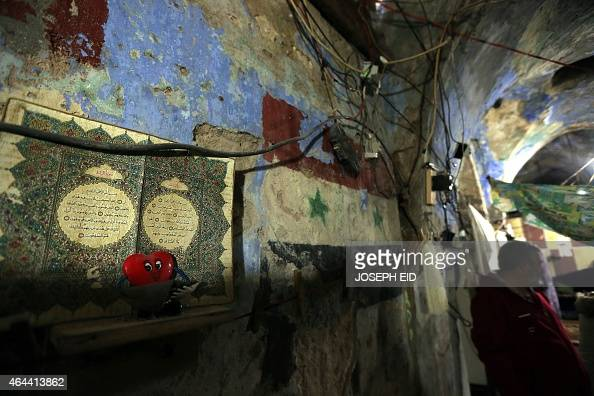 Syrian national Jihad alMohamed stands inside his home in a fading Jewish Synagogue in the old city of Lebanon's southern city of Sidon where he has...