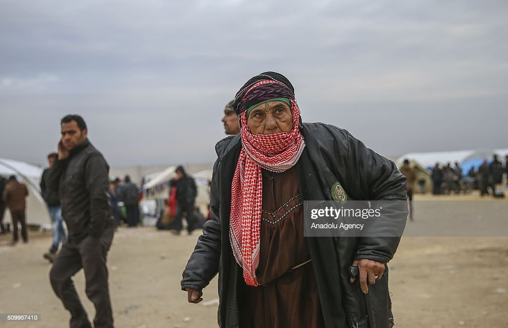 A Syrian old woman, who fled bombing in Aleppo, is seen at a tent city close to the Bab al-Salam border crossing on Turkish-Syrian border near Azaz town of Aleppo, Syria on February 13, 2016. Russian airstrikes have recently forced some 40,000 people to flee their homes in Syrias northern city of Aleppo.