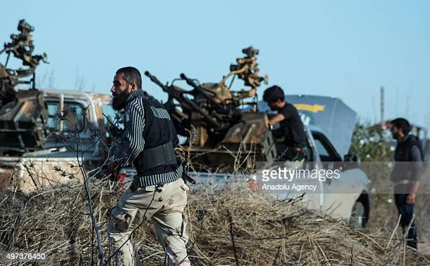 Syrian opponents attack Assad regime forces in the AlShaykh Maskin town of Daraa Syria on November 14 2015