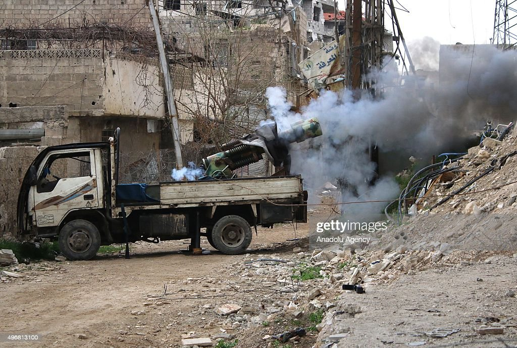 Syrian opponents attack the Assad regime forces with howitzers at the Cobar district in Damascus Syria on November 12 2015