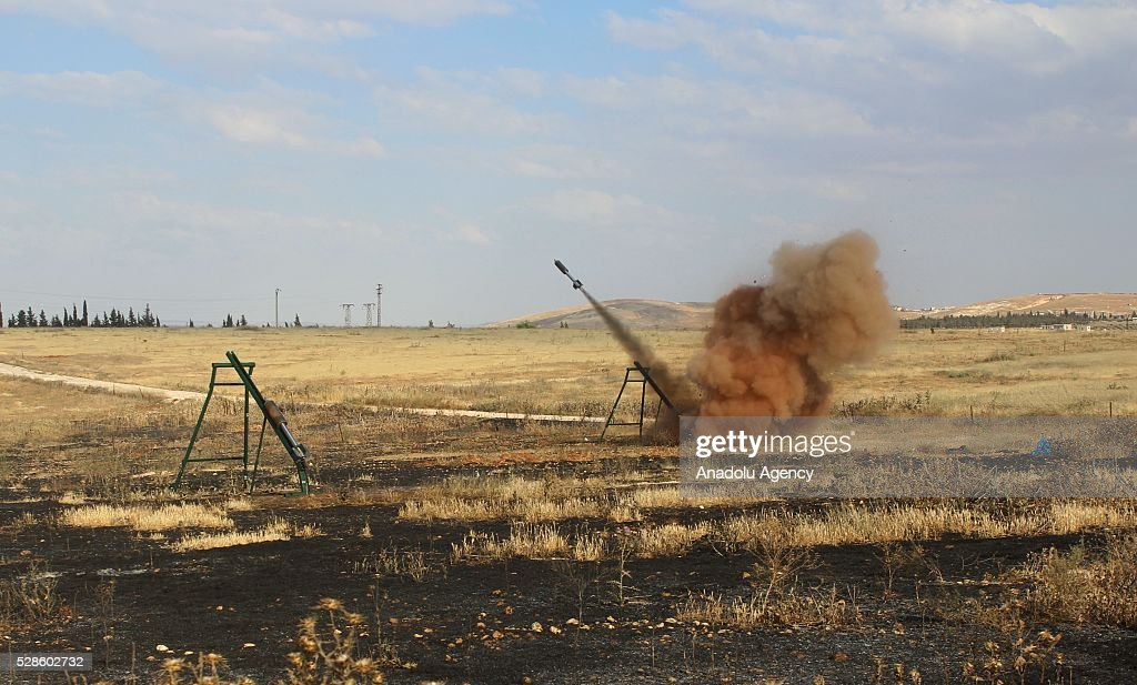 Syrian opponents fire rockets as they fight against the Assad regime forces in the Khan Tuman town of Aleppo, Syria on May 5, 2016 after Assad regime violated the ceasefire.