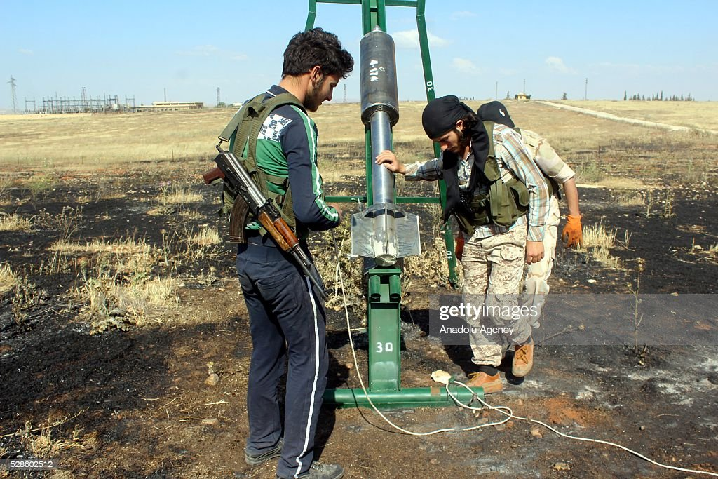 Syrian opponents prepare to fire rockets as they fight against the Assad regime forces in the Khan Tuman town of Aleppo, Syria on May 5, 2016 after Assad regime violated the ceasefire.