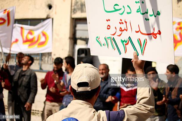Syrian opponents stage a protest against the Assad regime and Russia in the opposition controlled Daraa province of Syria on March 7 2016