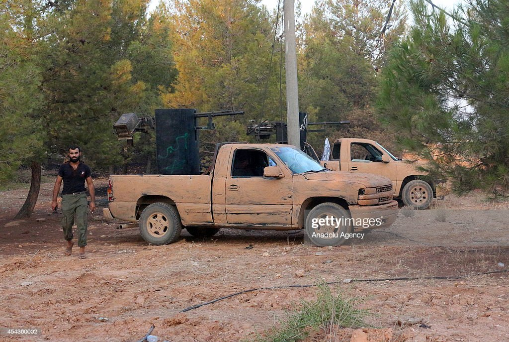 Syrian opposition brigades and members of Islamic Front on full alert during the assault on industrial zone and prison that controlled by Assad regime forces in north region of Aleppo, Syria on August 28, 2014. Syrian opposition brigades and members of Islamic Front stage attacks with tanks and missiles to the locations of Assad regime forces in north region of Aleppo, Syria.