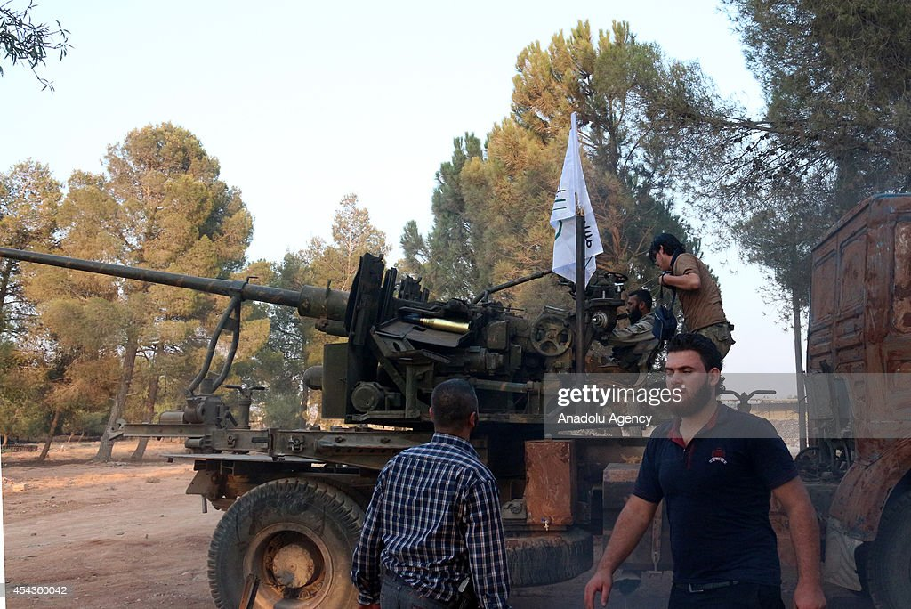 Syrian opposition brigades and members of Islamic Front on full alert before the assault on industrial zone and prison that controlled by Assad regime forces in north region of Aleppo, Syria on August 28, 2014. Syrian opposition brigades and members of Islamic Front stage attacks with tanks and missiles to the locations of Assad regime forces in north region of Aleppo, Syria.
