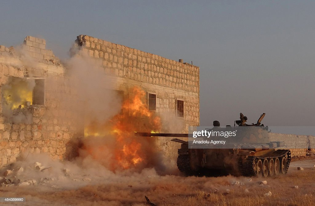 Syrian opposition brigades and members of Islamic Front stage attacks with tanks to the locations of Assad regime forces in north region of Aleppo, Syria on August 28, 2014.