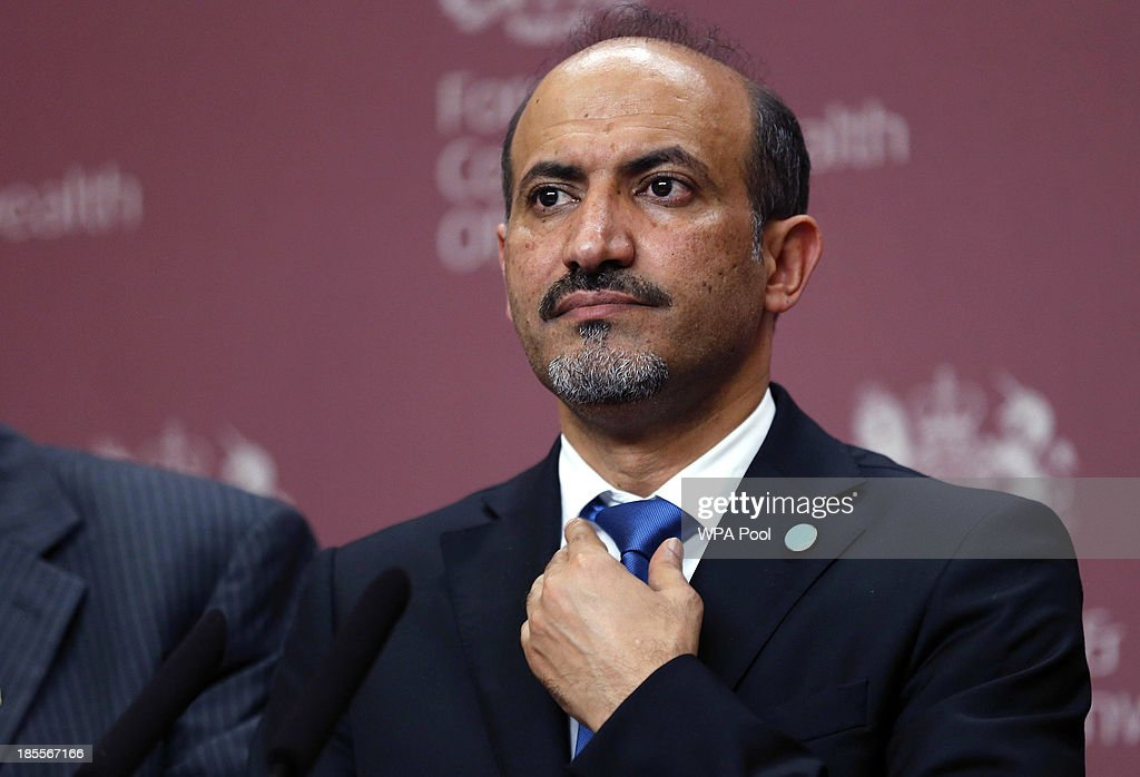 Syrian opposition chief Ahmad Jarba adjusts his tie at a news conference at the Foreign and Commonwealth Office on October 22, 2013 in London, England. John Kerry attended a meeting, hosted by British Foreign Secretary William Hague which brought together Foreign Ministers from the USA, Egypt, France, Germany, Italy, Jordan, Qatar, Saudi Arabia, Turkey and UAE as well as representatives from the Syrian National Coalition. Plans for talks to end the fighting in Syria were in jeopardy today after the opposition refused to attend unless President Bashar al-Assad is forced from power and a furious Saudi Arabia made clear it would no longer co-operate with the United States over the civil war.