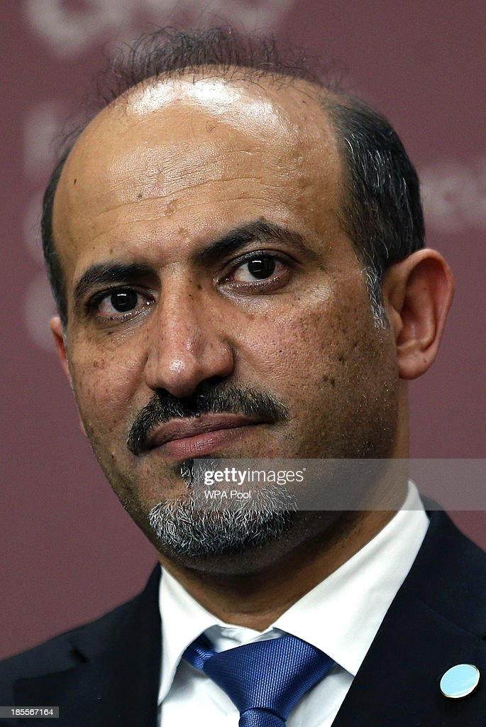 Syrian opposition chief Ahmad Jarba speaks at a news conference at the Foreign and Commonwealth Office on October 22, 2013 in London, England. John Kerry attended a meeting, hosted by British Foreign Secretary William Hague which brought together Foreign Ministers from the USA, Egypt, France, Germany, Italy, Jordan, Qatar, Saudi Arabia, Turkey and UAE as well as representatives from the Syrian National Coalition. Plans for talks to end the fighting in Syria were in jeopardy today after the opposition refused to attend unless President Bashar al-Assad is forced from power and a furious Saudi Arabia made clear it would no longer co-operate with the United States over the civil war.