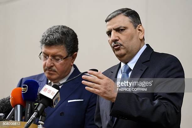 Syrian opposition chief Riad Hijab gestures next to High Negotiations Committee spokesman Salem alMeslet during a press conference after Syrian peace...