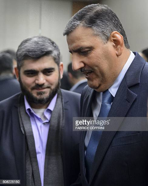 Syrian opposition chief Riad Hijab leaves with Chief negotiator for the main Syrian opposition body and rebel group Army of Islam Mohammed Alloush a...