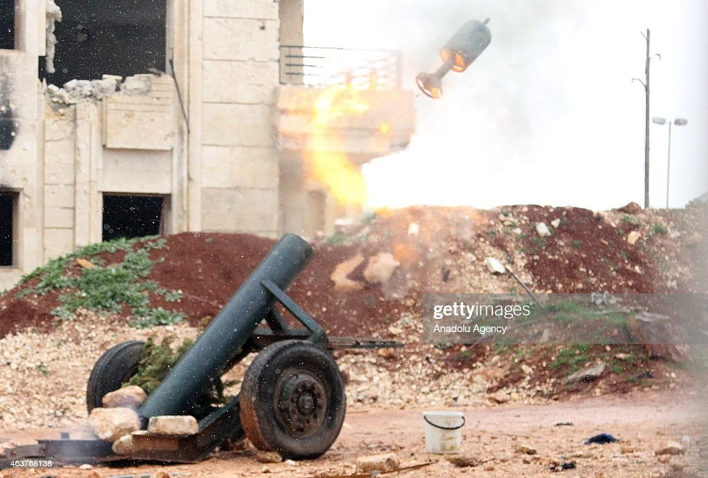 Syrian opposition Damascus Front members make preparations ahead of their attacks with howitzers, made up by propane cylinder and named 'hell', to regime forces located in Rityan area, Aleppo, Syria on February 18, 2015.