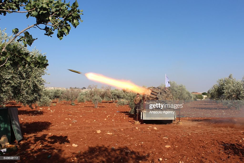 Syrian opposition forces attack Asad forces with howitzers at Melah region in Aleppo, Syria on June 29, 2016.