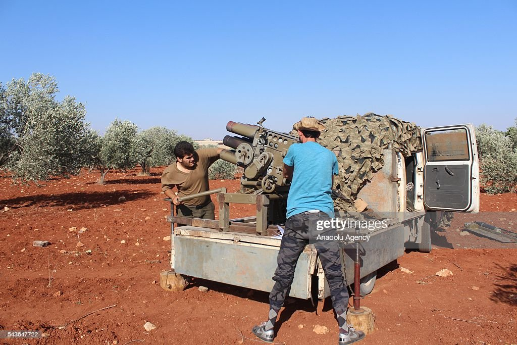 Syrian opposition forces prepare to attack Asad forces with howitzers at Melah region in Aleppo, Syria on June 29, 2016.