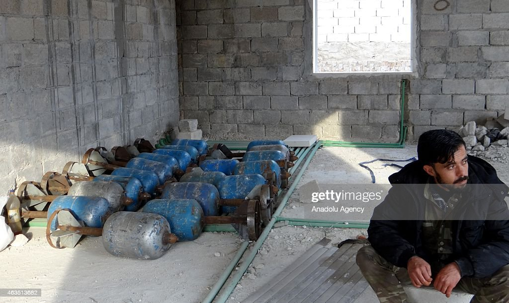 Syrian opposition Islamic Front members make preparations ahead of their attacks with howitzers, made up by propane cylinder and named 'hell', to regime forces located in Melah region, on the north side of Aleppo, Syria on February 15, 2015.